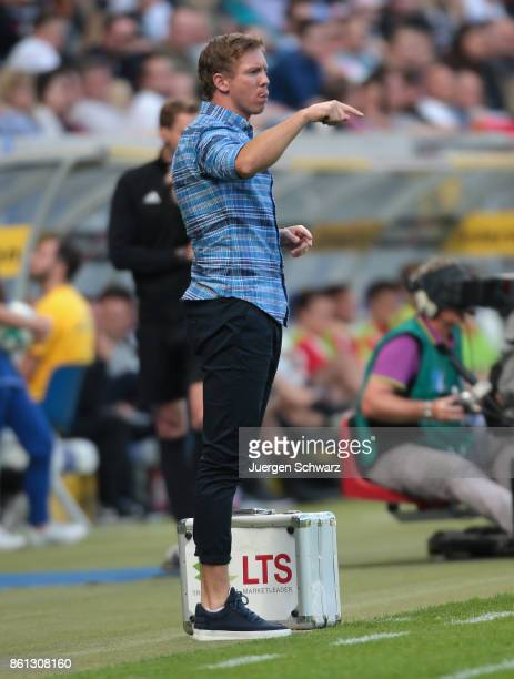 Manager Julian Nagelsmann of Hoffenheim gives instructions during the Bundesliga match between TSG 1899 Hoffenheim and FC Augsburg at Wirsol...
