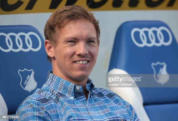 Manager Julian Nagelsmann of Hoffenheim sits beside the pitch at the Bundesliga match between TSG 1899 Hoffenheim and FC Augsburg at Wirsol...