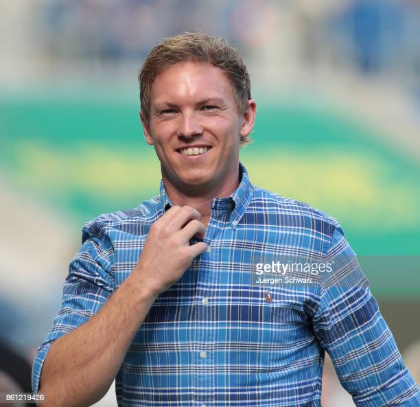 Manager Julian Nagelsmann of Hoffenheim smiles when he stands beside the pitch at the Bundesliga match between TSG 1899 Hoffenheim and FC Augsburg at...