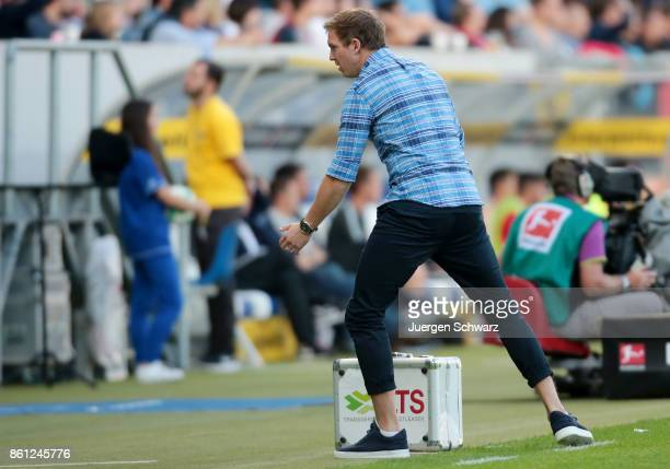Manager Julian Nagelsmann of Hoffenheim stands beside the pitch during the Bundesliga match between TSG 1899 Hoffenheim and FC Augsburg at Wirsol...