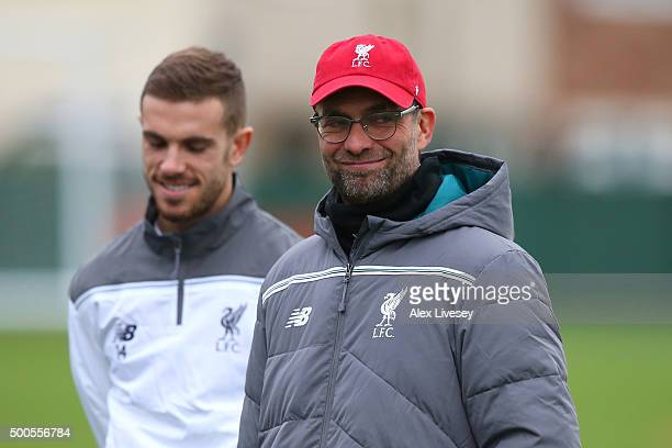 Manager Jurgen Klopp and Jordan Henderson look on during the Liverpool training session at the Melwood training ground on December 9 2015 in...
