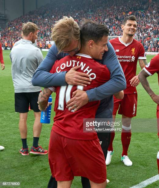 Manager Jurgen Klopp of Liverpool embraces Philippe Coutinho after the Premier League match between Liverpool and Middlesbrough at Anfield on May 21...