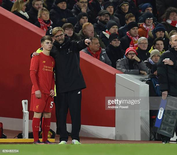 Manager Jurgen Klopps speaks to Ben Woodburn of Liverpool during the EFL Cup QuarterFinal match between Liverpool and Leeds United at Anfield on...