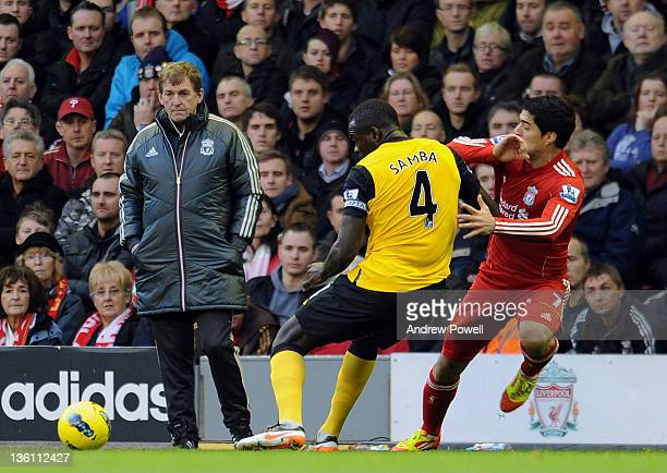 Manager Kenny Dalglish of Liverpool watches Christopher Samba of Blackburn compete for the ball with Luis Suarez of Liverpool during the Barclays...