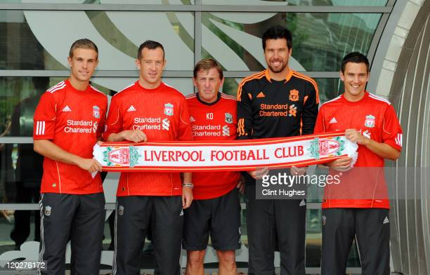 Manager Kenny Dalglish presents new signings Jordan Henderson Charlie Adam Alexander Doni and Stewart Downing of Liverpool following a press...