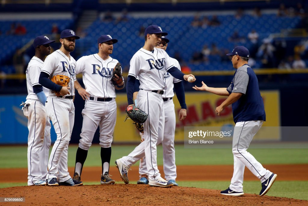 Manager Kevin Cash #16 of the Tampa Bay Rays comes out to take pitcher Blake Snell #4 off the mound during the seventh inning of a game against the Cleveland Indians on August 10, 2017 at Tropicana Field in St. Petersburg, Florida.