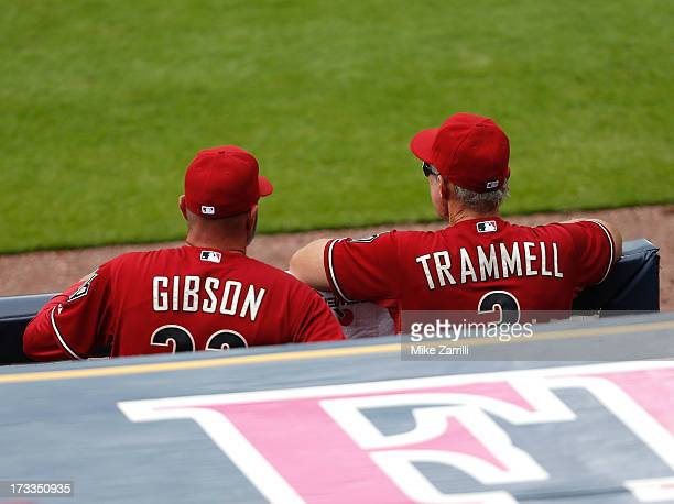 Manager Kirk Gibson and bench coach Alan Trammell of the Arizona Diamondbacks watch the action on the field from the dugout during the game against...