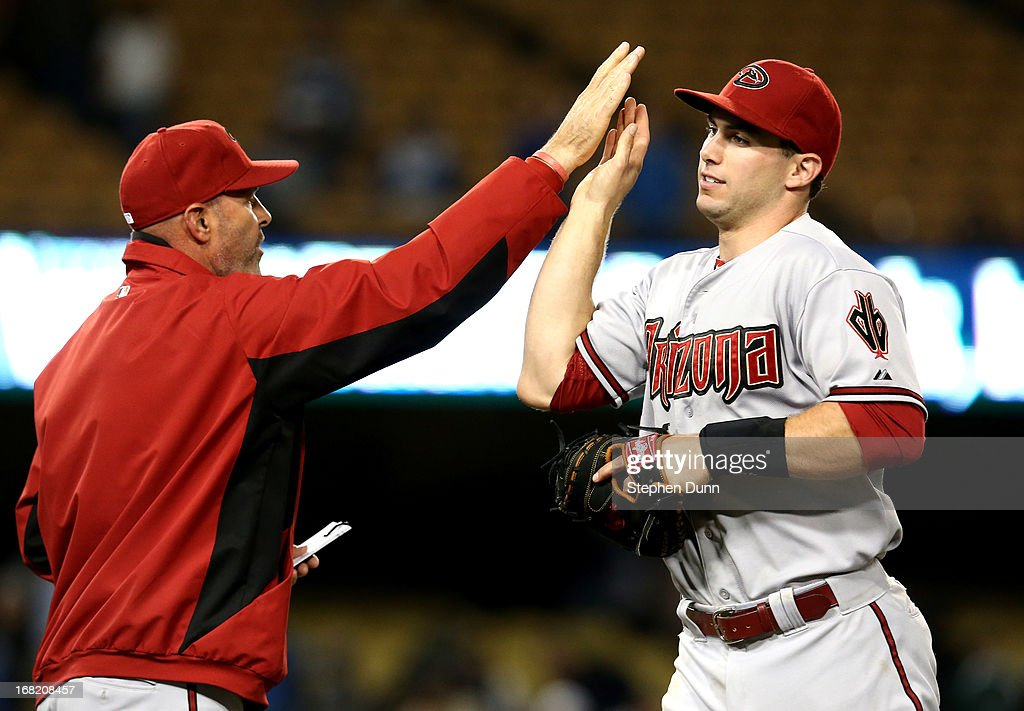 Manager <a gi-track='captionPersonalityLinkClicked' href=/galleries/search?phrase=Kirk+Gibson&family=editorial&specificpeople=207042 ng-click='$event.stopPropagation()'>Kirk Gibson</a> and first baseman <a gi-track='captionPersonalityLinkClicked' href=/galleries/search?phrase=Paul+Goldschmidt&family=editorial&specificpeople=7511120 ng-click='$event.stopPropagation()'>Paul Goldschmidt</a> #4 the Arizona Diamondbacks high five after the game against the Los Angeles Dodgers at Dodger Stadium on May 6, 2013 in Los Angeles, California. The Diamondbacks won 9-2.