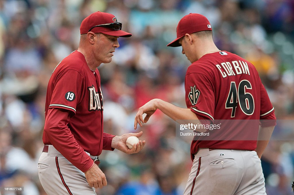 Manager <a gi-track='captionPersonalityLinkClicked' href=/galleries/search?phrase=Kirk+Gibson&family=editorial&specificpeople=207042 ng-click='$event.stopPropagation()'>Kirk Gibson</a> #23 comes to the mound to relieve Patrick Corbin #46 of the Arizona Diamondbacks in the fifth inning of a game against the Colorado Rockies at Coors Field on September 22, 2013 in Denver, Colorado.