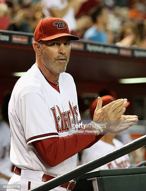 Manager Kirk Gibson of the Arizona Diamondbacks applauds in the dugout during the MLB game against the San Diego Padres at Chase Field on September...