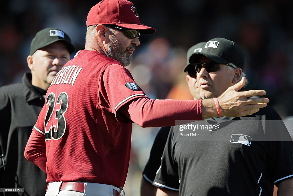Manager <a gi-track='captionPersonalityLinkClicked' href=/galleries/search?phrase=Kirk+Gibson&family=editorial&specificpeople=207042 ng-click='$event.stopPropagation()'>Kirk Gibson</a> of the Arizona Diamondbacks gets ejected by first base umpire and crew chief Tom Hallion after he reversed his own call against the San Francisco Giants in the 10th inning at AT&T Park on September 8, 2013 in San Francisco, California. The Giants won 3-2 in 11 innnings.