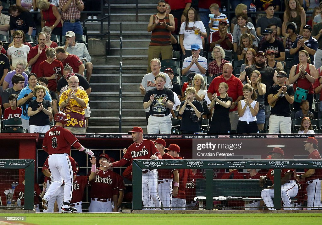 Manager Kirk Gibson #23 of the Arizona Diamondbacks high-fives Miguel Montero #26 after he hit a solo home run against the Philadelphia Phillies during the second inning of the MLB game at Chase Field on May 12, 2013 in Phoenix, Arizona.