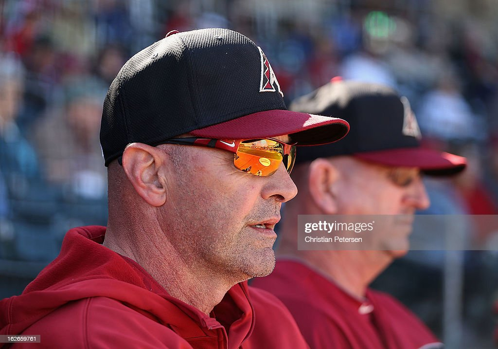 Manager Kirk Gibson (L) of the Arizona Diamondbacks looks on during the spring training game against the Kansas City Royals at Surprise Stadium on February 25, 2013 in Surprise, Arizona.
