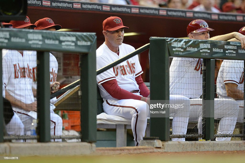 Manager Kirk Gibson #23 of the Arizona Diamondbacks looks on from the bench against the San Diego Padres at Chase Field on May 24, 2013 in Phoenix, Arizona.