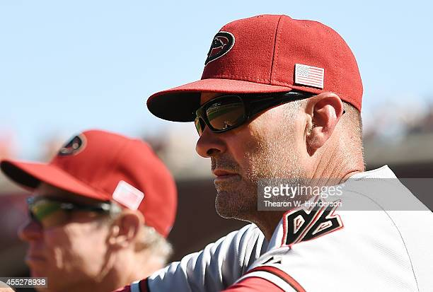 Manager Kirk Gibson of the Arizona Diamondbacks looks on from the dugout against the San Francisco Giants in the top of the eighth inning at ATT Park...