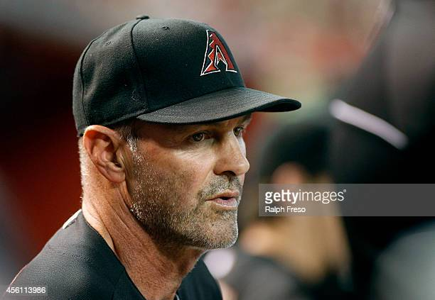 Manager Kirk Gibson of the Arizona Diamondbacks looks on from the dugout during the second inning of a MLB game against the San Diego Padres at Chase...