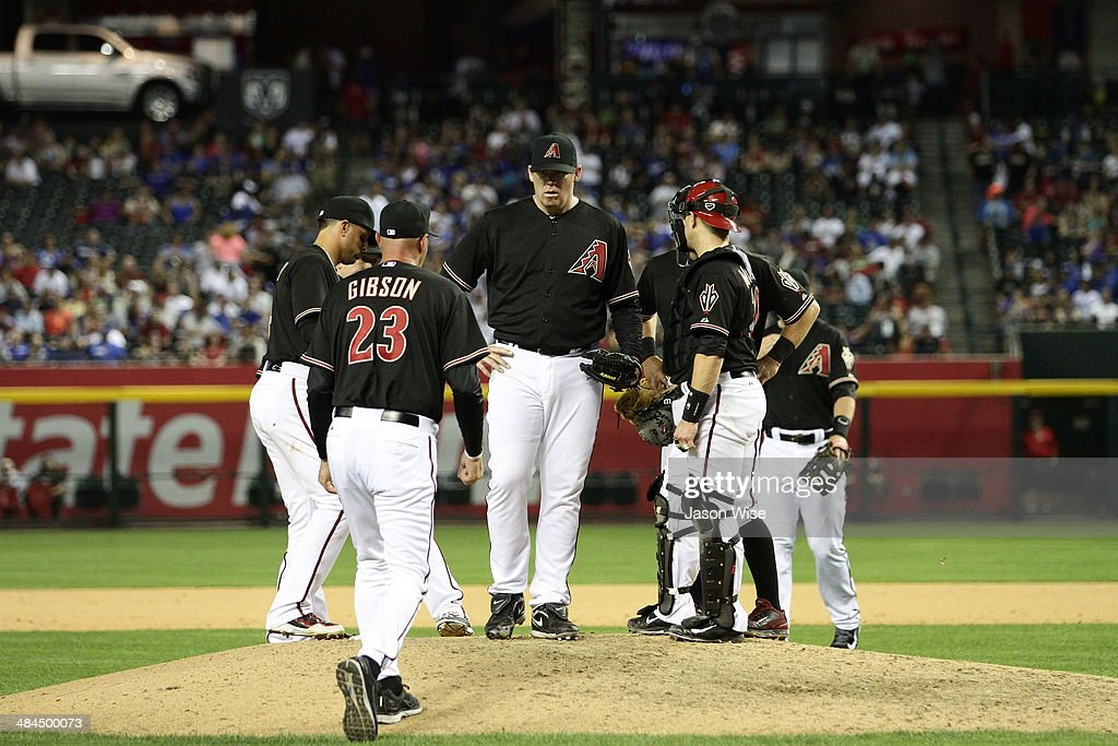 Manager Kirk Gibson #23 of the Arizona Diamondbacks pulls <a gi-track='captionPersonalityLinkClicked' href=/galleries/search?phrase=J.J.+Putz&family=editorial&specificpeople=243125 ng-click='$event.stopPropagation()'>J.J. Putz</a> #40 in the eighth inning against the Los Angeles Dodgers at Chase Field on April 12, 2014 in Phoenix, Arizona.
