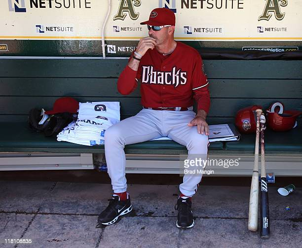 Manager Kirk Gibson of the Arizona Diamondbacks sits in the dugout before the game against the Oakland Athletics at the OaklandAlameda County...