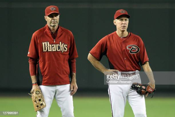 Manager Kirk Gibson of the Arizona Diamondbacks stands with bench coach Alan Trammell before Game Three of the National League Division Series...