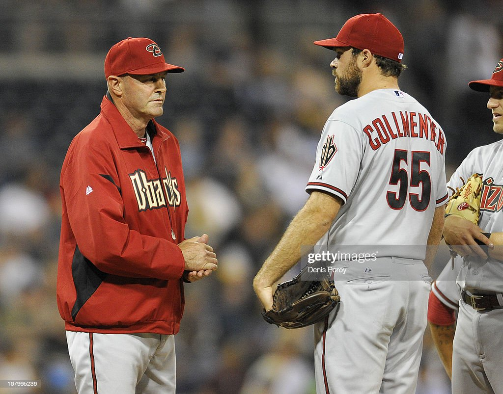 Manager <a gi-track='captionPersonalityLinkClicked' href=/galleries/search?phrase=Kirk+Gibson&family=editorial&specificpeople=207042 ng-click='$event.stopPropagation()'>Kirk Gibson</a> #23 of the Arizona Diamondbacks talks with <a gi-track='captionPersonalityLinkClicked' href=/galleries/search?phrase=Josh+Collmenter&family=editorial&specificpeople=7510566 ng-click='$event.stopPropagation()'>Josh Collmenter</a> #55 before taking him out of the game in the eighth inning of a baseball game against the San Diego Padres at Petco Park on May 3, 2013 in San Diego, California.