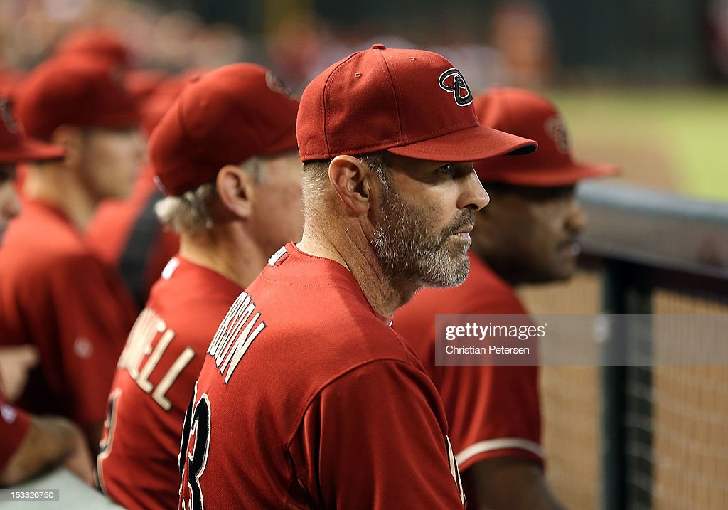 Manager Kirk Gibson of the Arizona Diamondbacks watches from the dugout during the MLB game against the Colorado Rockies at Chase Field on October 3, 2012 in Phoenix, Arizona.