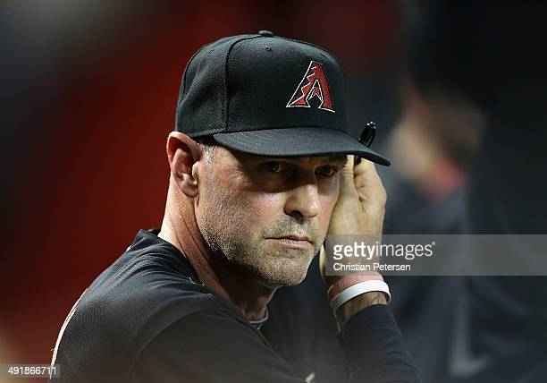 Manager Kirk Gibson of the Arizona Diamondbacks watches from the dugout during the MLB game against the Los Angeles Dodgers at Chase Field on May 17...
