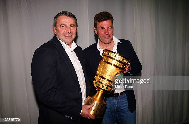 Manager Klaus Allofs and head coach Dieter Hecking pose with the DFB Cup during the VfL Wolfsburg Champions party after winning the German DFB Cup...