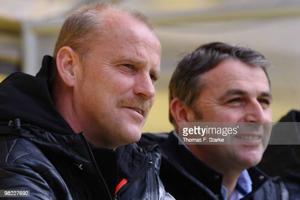 Manager Klaus Allofs of Bremen and to head coach Thomas Schaaf look on prior to the Bundesliga match between Borussia Dortmund and SV Werder Bremen...