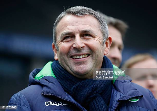 Manager Klaus Allofs of Wolfsburg laughs prior to the Bundesliga match between Hertha BSC and VfL Wolfsburg at Olympiastadion on February 20 2016 in...