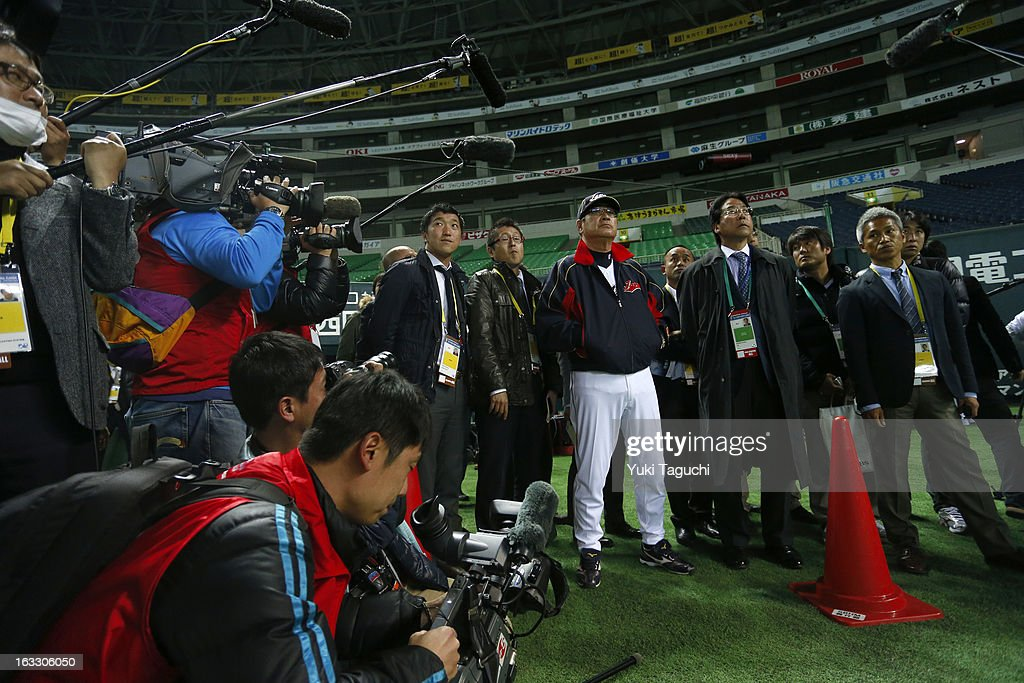 Manager Koji Yamamoto #88 of Team Japan is surrounded by media during the World Baseball Classic workout day at the Yahoo Dome on February 27, 2013 in Fukuoka, Japan.