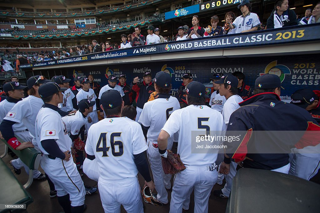 Manager Koji Yamamoto #88 (center) of Team Japan talks to his team in the dugout before the semi-final game against Team Japan in the championship round of the 2013 World Baseball Classic on Sunday, March 17, 2013 at AT&T Park in San Francisco, California.