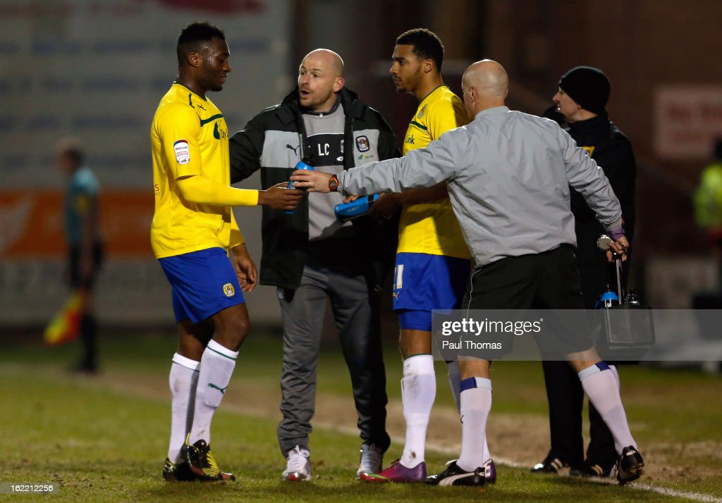 Manager Lee Carsley (C) of Coventry speaks to his player Nathan Cameron (L) during the Johnstone's Paint Trophy Northern Section Final Second Leg match between Crewe Alexandra and Coventry City at the Alexandra Stadium on February 20, 2013 in Crewe, England.