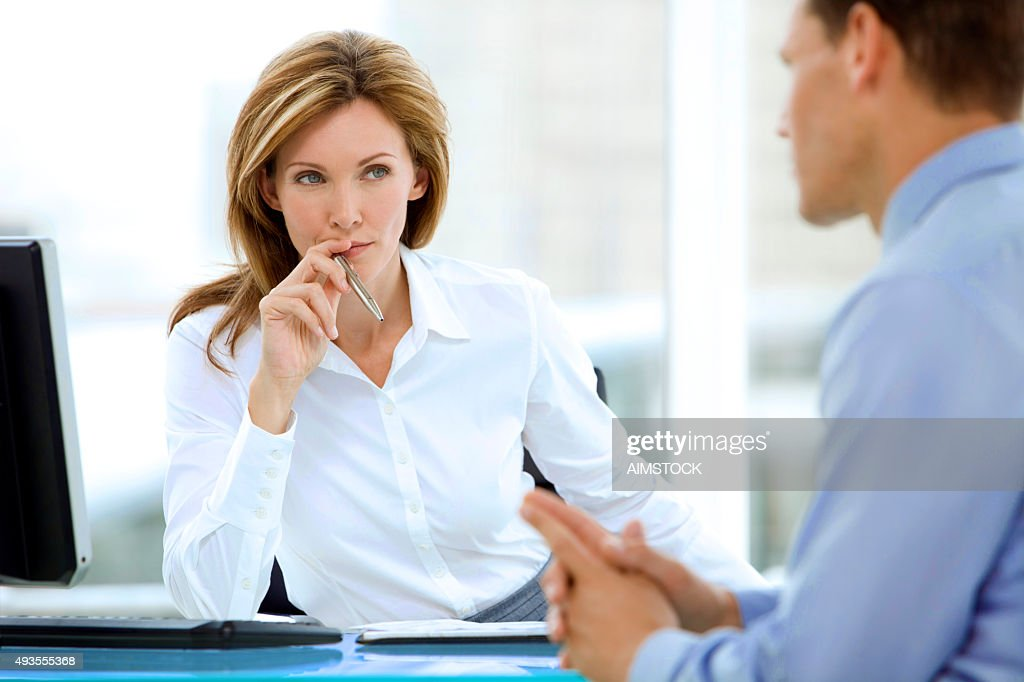 Manager listening to businessman