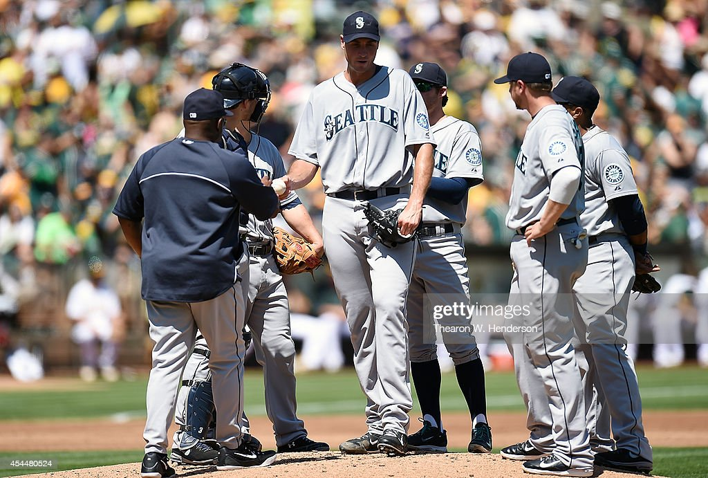 Manager <a gi-track='captionPersonalityLinkClicked' href=/galleries/search?phrase=Lloyd+McClendon&family=editorial&specificpeople=240690 ng-click='$event.stopPropagation()'>Lloyd McClendon</a> #23 of the Seattle Mariners takes the ball from starting pitcher Chris Young #53 taking Young out of the game against the Oakland Athletics in the bottom of the first inning at O.co Coliseum on September 1, 2014 in Oakland, California.