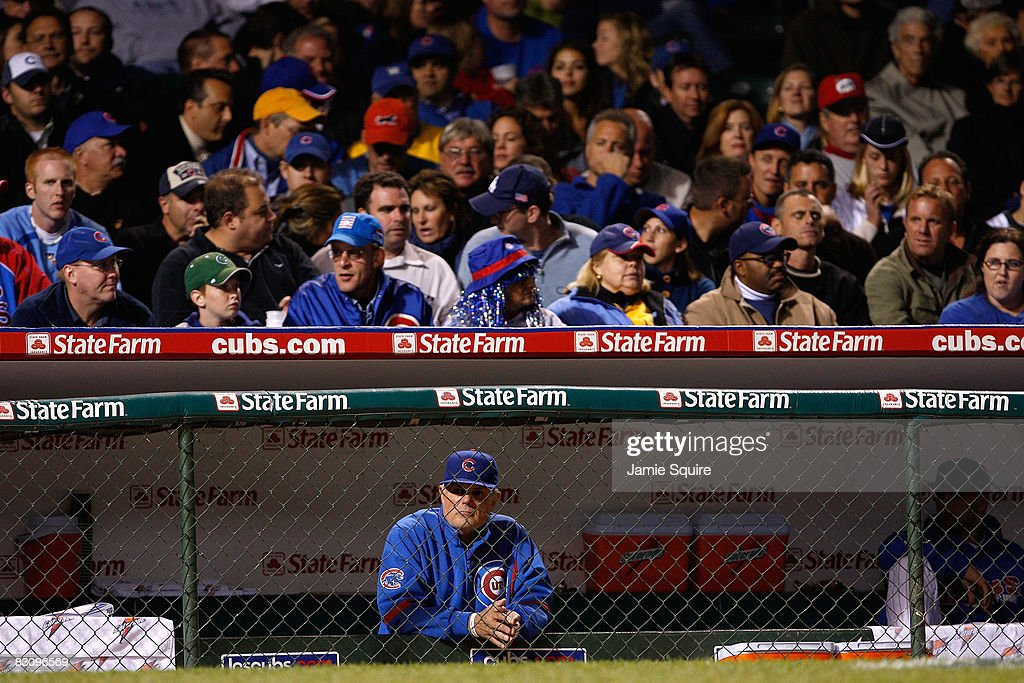 Manager Lou Piniella #41 of the Chicago Cubs looks on from the dugout against the Los Angeles Dodgers in Game Two of the NLDS during the 2008 MLB Playoffs at Wrigley Field on October 2, 2008 in Chicago, Illinois.