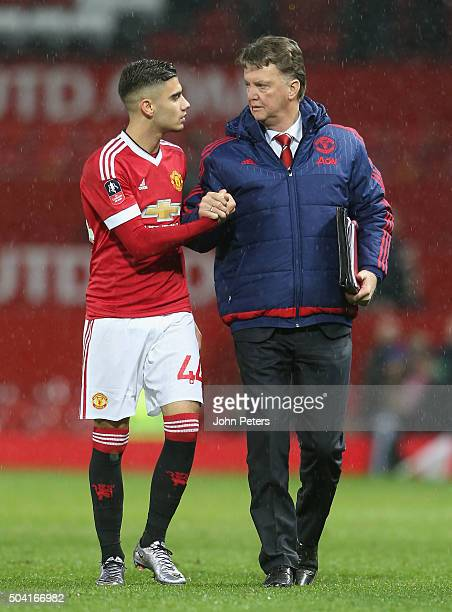 Manager Louis van Gaal and Andreas Pereira of Manchester United walk off after the Emirates FA Cup Third Round match between Manchester United and...