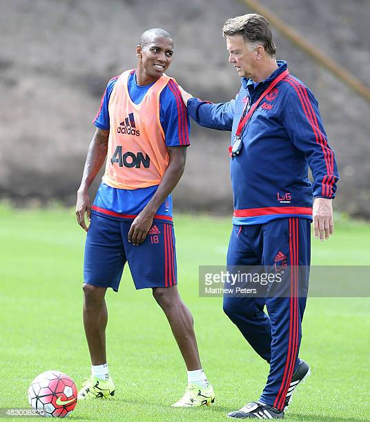 Manager Louis van Gaal and Ashley Young of Manchester United in action during a first team training session at Aon Training Complex on August 5 2015...