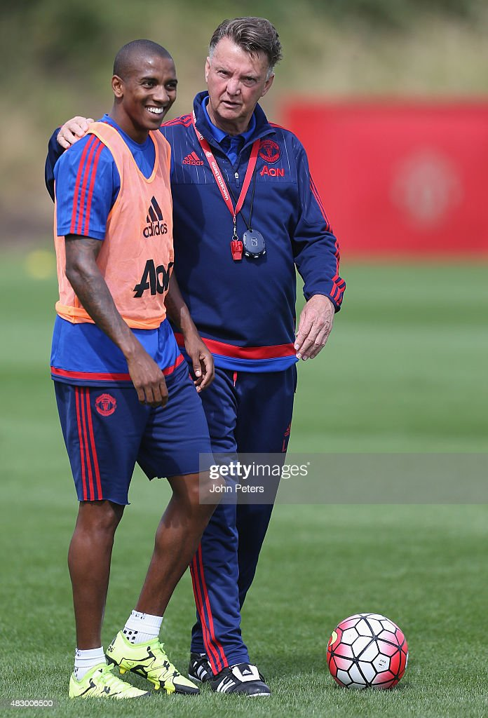 Manager Louis van Gaal and <a gi-track='captionPersonalityLinkClicked' href=/galleries/search?phrase=Ashley+Young&family=editorial&specificpeople=623155 ng-click='$event.stopPropagation()'>Ashley Young</a> of Manchester United in action during a first team training session at Aon Training Complex on August 5, 2015 in Manchester, England.