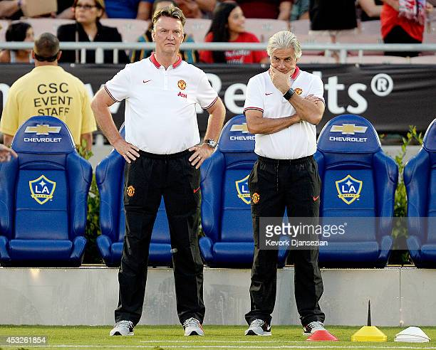 Manager Louis van Gaal and chief opposition scout Marcel Bout of Manchester United follow team warm ups during the preseason friendly match between...