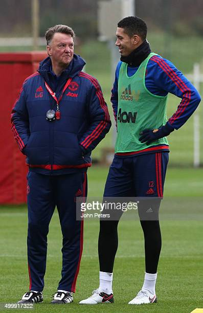 Manager Louis van Gaal and Chris Smalling of Manchester United in action during a first team training session at Aon Training Complex on December 4...