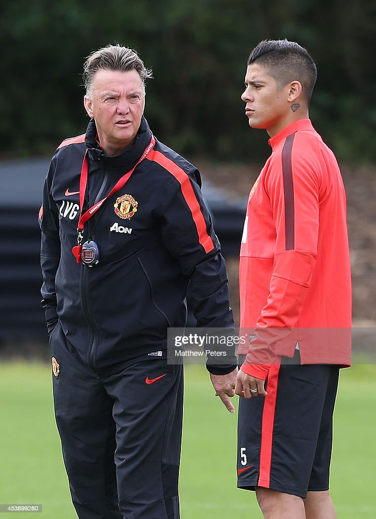 Manager Louis van Gaal and <a gi-track='captionPersonalityLinkClicked' href=/galleries/search?phrase=Marcos+Rojo&family=editorial&specificpeople=6740047 ng-click='$event.stopPropagation()'>Marcos Rojo</a> of Manchester United in action during a first team training session at Aon Training Complex on August 21, 2014 in Manchester, England.