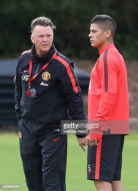 Manager Louis van Gaal and Marcos Rojo of Manchester United in action during a first team training session at Aon Training Complex on August 21 2014...