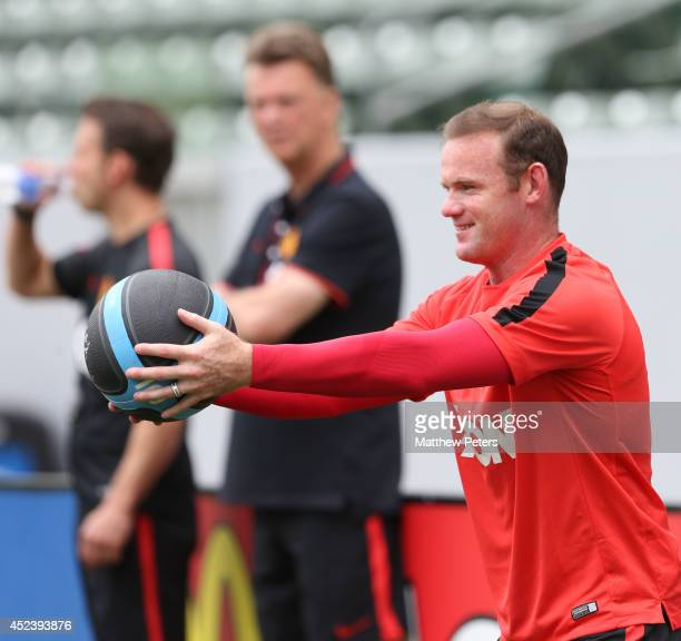 Manager Louis van Gaal and Wayne Rooney of Manchester United in action during a training session as part of their preseason tour of the United States...