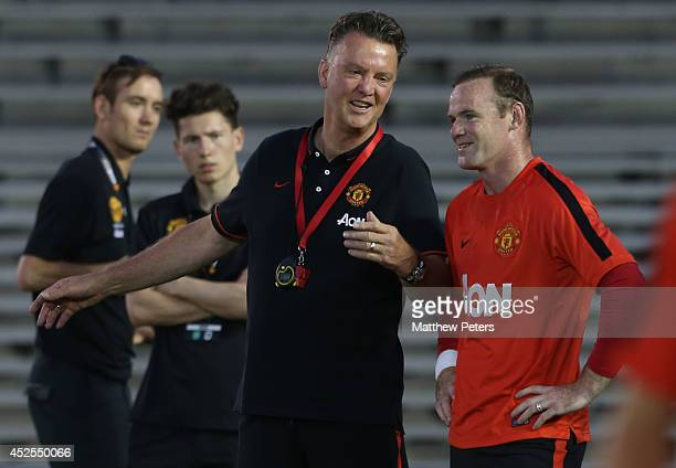 Manager Louis van Gaal and Wayne Rooney of Manchester United in action during an open training session as part of their preseason tour to the United...