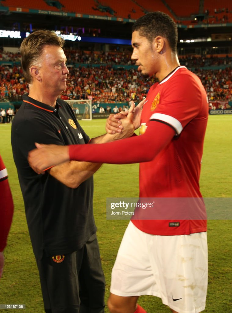 Manager Louis van Gaal of Manchester United congratulates Chris Smalling after the pre-season friendly match between Manchester United and Liverpool at Sun Life Stadium on August 4, 2014 in Miami Gardens, Florida.