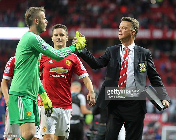 Manager Louis van Gaal of Manchester United congratulates David de Gea after the Barclays Premier League match between Manchester United and...