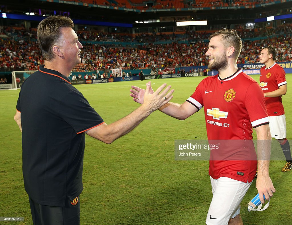 Manager Louis van Gaal of Manchester United congratulates Luke Shaw after the pre-season friendly match between Manchester United and Liverpool at Sun Life Stadium on August 4, 2014 in Miami Gardens, Florida.