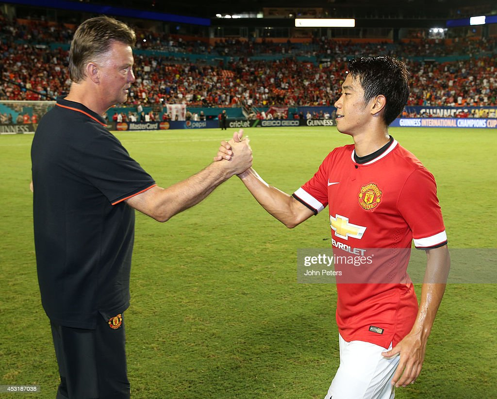 Manager Louis van Gaal of Manchester United congratulates Shinji Kagawa after the pre-season friendly match between Manchester United and Liverpool at Sun Life Stadium on August 4, 2014 in Miami Gardens, Florida.