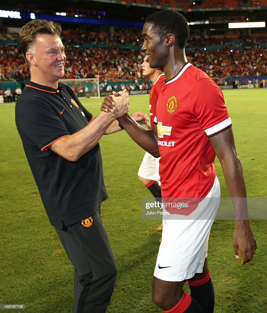 Manager Louis van Gaal of Manchester United congratulates Tyler Blackett after the pre-season friendly match between Manchester United and Liverpool at Sun Life Stadium on August 4, 2014 in Miami Gardens, Florida.