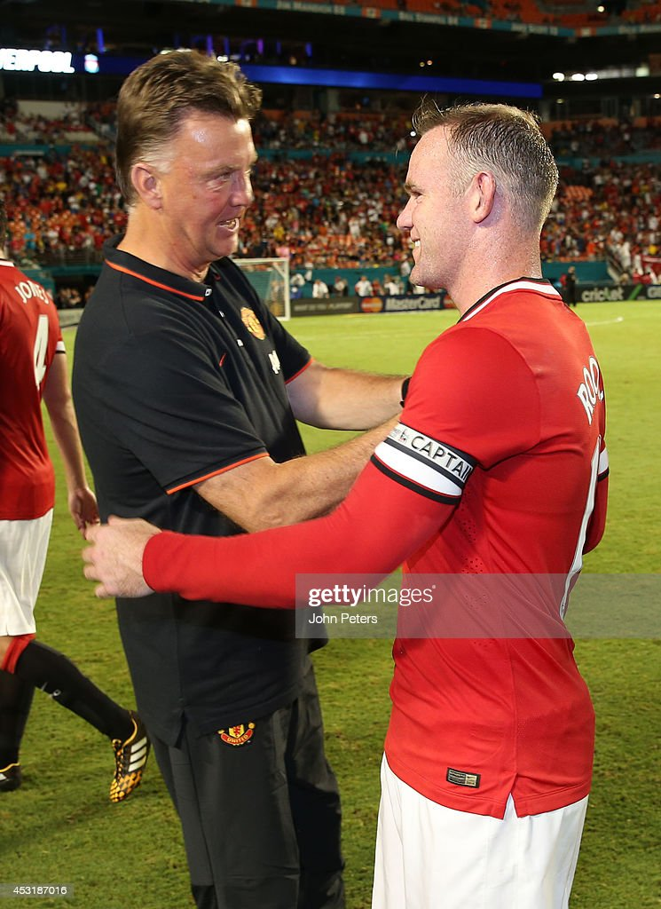 Manager Louis van Gaal of Manchester United congratulates <a gi-track='captionPersonalityLinkClicked' href=/galleries/search?phrase=Wayne+Rooney&family=editorial&specificpeople=157598 ng-click='$event.stopPropagation()'>Wayne Rooney</a> after the pre-season friendly match between Manchester United and Liverpool at Sun Life Stadium on August 4, 2014 in Miami Gardens, Florida.